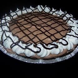 German Sweet Chocolate Pie Recipe - An easy frozen German chocolate mousse that is whipped up with cream cheese and frozen whipped topping.
