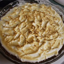 Coconut Cream Pie IV Recipe - A creamy, thick and delicious coconut custard is cooked up and poured into a baked pie shell and smothered with meringue. Only a few minutes in a hot oven turns the meringue golden brown.