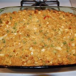 Momma's Cornbread Dressing Recipe - Crumbled cornbread, chopped hard-boiled eggs, onion, garlic, sage and celery are in this stuffing or dressing. It's moistened with chicken and turkey broth and can be used to stuff a 12 to 15 pound turkey.