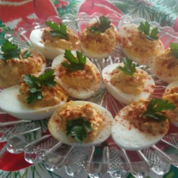 Zippy Deviled Eggs Recipe - Hot yellow pepper sauce, Dijon mustard, and mayonnaise blend with egg yolks for the filling in this deviled eggs recipe.