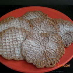 "Chocolate Pizzelles Recipe - These are thin waferlike cookies and you must have a pizzelle iron to make them.  The Italians call them ""Pizzelle Alle Nocciole""."