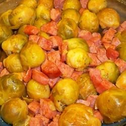 Dressed Up Brussels Sprouts Recipe - A quick and easy side dish from the microwave.  Combining Brussels sprouts with kielbasa sausage and tomato juice is a new twist on a familiar favorite.