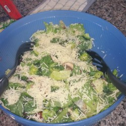 Broccoli Salad with Margarita Dressing Recipe - This quick salad is made with raw broccoli, romaine lettuce, grape tomatoes and a few other ingredients that marinate in a simple olive oil and lime dressing.