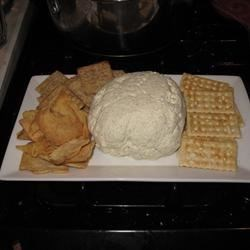 Garlic Cheese Ball Recipe - A great cheese ball for garlic lovers.  Spicy enough to give a little zing and creamy enough to satisfy anyone. Serve with all kinds of crackers or bread.