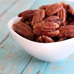 Candied Curried Pecans Recipe - This recipe for candied pecans has a hint of curry mixed in a buttery and sweet coating for a nice snack during the holiday season.