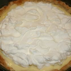 Sour Cream Lemon Pie Recipe - First you make a very creamy and rich egg custard. Then you stir in butter, fresh lemon juice, bits of lemon rind and sour cream. Pour this refreshing filling into a baked pie shell, chill the pie, and garnish it with sprigs of mint and thin slices of lemons.
