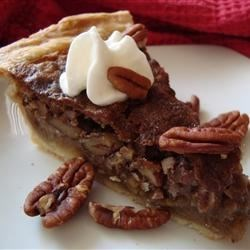 Pecan Pie V Recipe and Video - A pecan pie without the corn syrup. Pecans, white sugar, and brown sugar are combined to create a satisfying dessert.