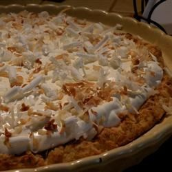 Coconut Cream Pie I Recipe - This is a quick pie that tastes like it took hours. Shredded coconut is folded into vanilla pudding and whipped topping, and then spooned into a graham cracker crust. More whipped topping is added along with a sprinkling of coconut.