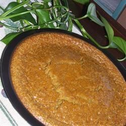 Impossible Pumpkin Pie Recipe - Pumpkin puree is mixed with evaporated milk, eggs, spices, and flour in this pie which makes its own crust.