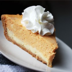 Double Layer Pumpkin Cheesecake Recipe and Video - This 5-star pumpkin cheesecake layers pumpkin and cream cheese for a delicious display, combining the best of two treats.