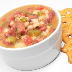 Country Kitchen Calico Bean Soup Recipe - Don't let the long ingredient list intimidate. Just throw ham, several types of dried beans, and vegetables in a pot and simmer until it's ready.