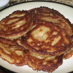 Potato Latkes II Recipe - Shred buttery Yukon Gold potatoes and stir together with cooked mashed potatoes, grated onion, eggs, matzo meal and kosher salt. Fried by the spoonful in hot oil or butter, these golden, crispy pancakes make a special holiday meal.