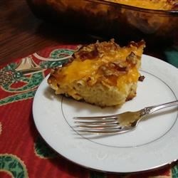 Holiday Apricot Kugel Recipe - A rich, fruity apricot kugel made with egg noodles, cottage cheese, preserves, and melted butter is topped with melted Cheddar cheese. It's a fantastic side dish for the holiday table or for a special brunch.