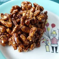 Chocolate Puffed Wheat Squares Recipe - MMMMMM... mom, can we have some more?  A deliciously chocolaty square that packs well in little one's lunches.. (big one's too!).  Enjoy!