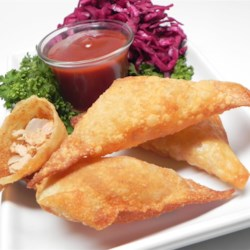 Memphis Wontons Recipe - Barbeque pulled pork is deep fried in wonton wrappers in this mashup of Southern bbq with an Asian-inspired twist.