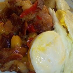 Jay's Hearty Breakfast Skillet Recipe - Potatoes, peppers, onion and mushrooms are all fried up with bacon, and smothered with cheese. Top with sunnyside-up eggs (or your favorite style) and serve with toast or muffins on the side.