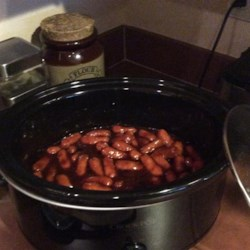 Cocktail Wieners Recipe - Cocktail smokies are placed in a slow cooker with barbeque sauce and grape jelly to make this crowd-pleasing cocktail wiener appetizer.