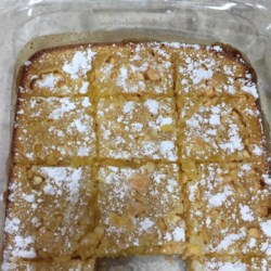 White Chocolate Lemon Bars Recipe - White chocolate chips mix with lemon juice and zest to give these bar cookies a deliciously different flavor combination.