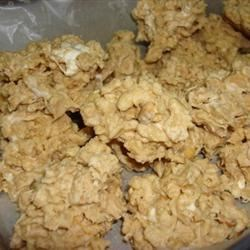 Almond Bark Drop Cookies Recipe - This cookie is easy to make and requires no baking. Peanuts, crisp rice cereal and marshmallows blend well for a satisfying treat.