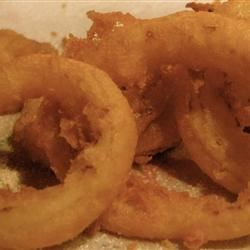 Beer-Batter Onion Rings Recipe - Light, crispy, very addictive onion rings! Use your favorite beer to make the batter.
