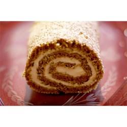 Pumpkin Roll I Recipe - For a dessert with an impressive presentation, try this spiced pumpkin cake roll filled with cream cheese frosting.