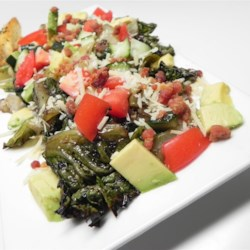 Grilled Chopped Salad Recipe - The flavor from grilling hearts of romaine adds depth to this grilled chopped salad, with tomatoes, avocado, cucumbers, and balsamic vinaigrette.