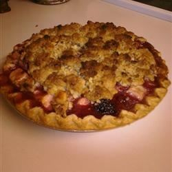 Four Fruit Pie Recipe - Apples, peaches, pears, and raspberries are topped with a buttery sweet pecan crumble in this family favorite.