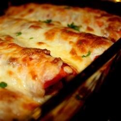 Chicken Enchiladas I Recipe - Chicken and a creamy tomato sauce are rolled up in tortillas for this chicken enchiladas recipe-very quick to assemble!