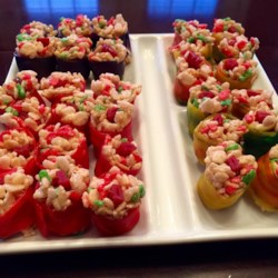 Candy Sushi Recipe - Crispy rice cereal and melted marshmallows are rolled in fruit rolls creating candy 'sushi' for a fun dessert for parties.