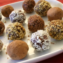 Easy Decadent Truffles Recipe - Insanely easy, but oh so rich!  Recipe makes a large amount but you can vary flavorings and coatings to make several different varieties.