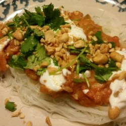 Spicy Peanut Shrimp Rice Noodles Recipe - Shrimp in a spicy peanut sauce are served with rice noodles, cilantro, peanuts, and yogurt for a refreshing Thai-inspired meal.