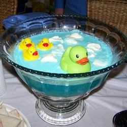 Baby Blue Punch Recipe and Video - I created this punch recipe when I went looking for a punch recipe for my Baby Shower. I really wanted blue punch because I was having a boy this time. The ice cream melts somewhat and turns the punch a beautiful baby blue color leaving frothy blue and white clouds floating on top. Everyone thought it tasted great and asked for the recipe. Its also very adaptable to your taste. The sky's the limit. Try any flavor or color of unsweetened drink mix in place of the blue.