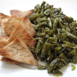 Fasoliyyeh Bi Z-Zayt (Syrian Green Beans with Olive Oil) Recipe and Video - I learned how to make this while visiting my husband's family in Syria.  It can be a healthy, fast, easy vegetarian/vegan main dish for lunch or dinner that is surprisingly filling when eaten with pita bread, or it can be a flavorful side dish.