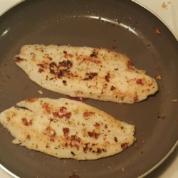 Easy Garlic Swai Fish Recipe - Swai fish is cooked with garlic and seasoned with Greek seasoning in this quick and easy recipe that is perfect for dinner on busy weeknights.