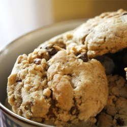 Cowboy Cookies (Dunkin' Platters) Recipe - These are great for dunking and are also large and satisfying enough for a man's appetite. Cowboy cookies should be about 2-1/2 inches in diameter.  My Grandma makes these cookies and I have enjoyed them since I was a kid.