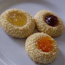 Sesame Thumbprint Cookies Recipe - Easy to make sesame seed coated shortbread-type of cookie with jam or preserves in the middle. You choose your favorite fruit. Very tasty.