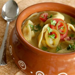 Cheese Tortellini in Curried Coconut Milk Recipe - Cheese tortellini, simmered in a curried tomato and coconut milk broth, blends two favorite comfort foods, soup and pasta.