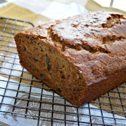 Date and Fig Quick Bread Recipe - Dates, figs, and walnuts are baked into a delightful quick bread that is a little different from the rest. Serve with cream cheese.