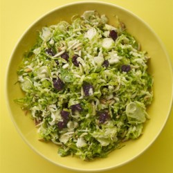 Brussels Sprout Slaw Recipe - Brussels sprouts, dried cherries, almonds, and Parmesan cheese are tossed in a simple vinaigrette in this quick and easy Brussels sprouts slaw.