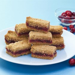 Cranberry Jam Bars Recipe - Cranberries are one of only three fruits native to North America, so what could be better to help celebrate an authentic Thanksgiving? The dough and jam can be made 3 days ahead and chilled separately.