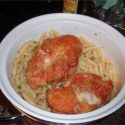 Anthony's Lime Chicken with Pasta Recipe - Breaded chicken breasts are pan-fried in olive oil, butter, and sliced garlic, then simmered with white wine, diced tomatoes, and lime wedges; served over pasta shells coated with olive oil, butter, Parmesan, and parsley.
