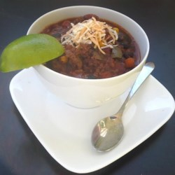 Grey Cup Chili Recipe - Served with thick slices of garlic bread, this hearty three-bean chili with vegetables is a Grey Cup party staple.