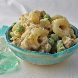 Crab Macaroni Salad Recipe - Flaked, canned crab meat stars in this macaroni salad for a refreshing summertime side dish.