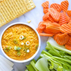 Buffalo Chicken Dip Recipe - Five simple ingredients in your slow cooker make this creamy, cheesy, zesty hot dip that tastes just like Buffalo chicken wings.