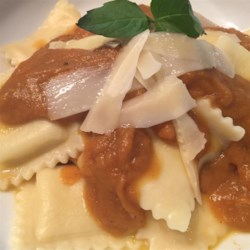 Cheese Ravioli with Pumpkin Sauce Recipe - Cheese ravioli topped with a sweet pumpkin sauce is a warm and comforting meal for cold winter evenings.