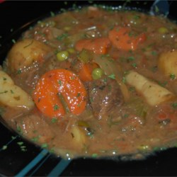 Christmas Eve Beef Stew Recipe - Here is a beef stew full of potatoes, carrots, celery and peas in a rosemary-tomato broth which is thickened with pearl tapioca.  It can be made in a slow cooker or a Dutch oven.