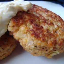 Potato Salmon Patties Recipe - Flaked salmon is blended with herbs, bread crumbs, and potato flakes to form tasty and versatile little pan-fried patties.