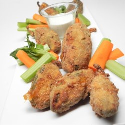 Jodi's Deep-Fried Stuffed Jalapenos Recipe - These delicious appetizers are perfect for a Mexican-style meal. Pickled jalapeno peppers are stuffed with Cheddar cheese, then fried until crisp. Serve with sour cream.