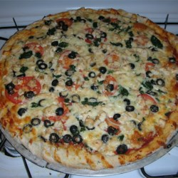 Pizza Crust II Recipe - This herbed crust is dusted with cornmeal for a real pizzeria touch.  The large quantity allows you to freeze some of the dough for the next time you want to be in pizza heaven.