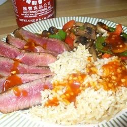 chile-rubbed steak, with stir fry veggies, brown rice, and a spicy orange sriracha chile sauce ;)